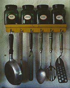 230px-Kitchen_utensils_hanging_below_a_spice_rack
